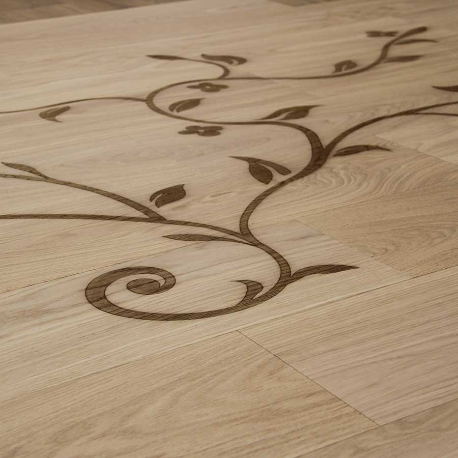 Wood burned design in a plank of Italian Wide Plank Wood Flooring from Tavolato Veneto