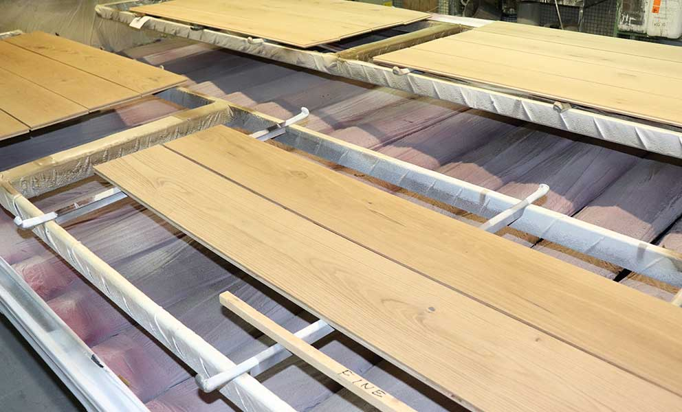 Two planks being stained at our factory | Italian Wide Plank Wood Flooring Tavolato Veneto